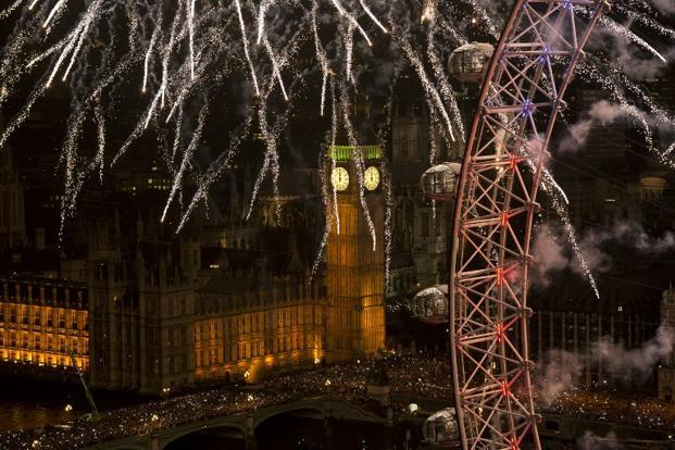Fireworks light up the Big Ben and the London Eye in central      London. AFP