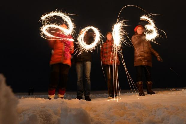 "People write ""2013"" with sparklers as they celebrate the New      Year on the shores of the Gulf of Finland in the city of      Zelenogorsk, about 55 km from Saint-Petersburg early on 1 January,      2013. AFP"