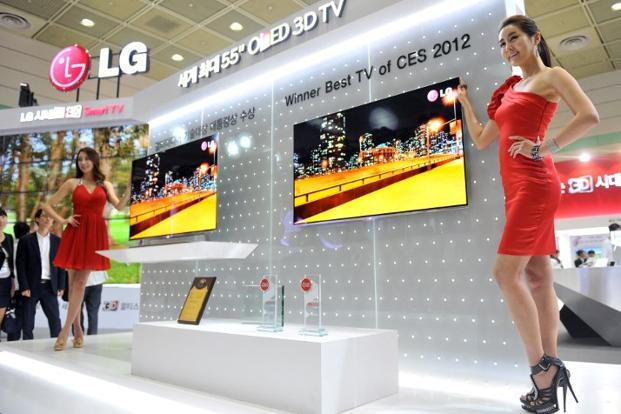 LG Electronics and Samsung showcased 55-inch (140 cm) OLED TVs a year ago and they are expected to be priced up to five times higher than LCD equivalents when they reach store shelves next month. Photo: AFP