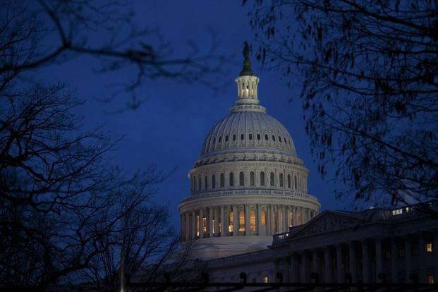 The US will no longer go over a fiscal cliff of tax hikes and spending cuts that had been due to come into force on Tuesday but other bruising budget battles lie ahead in the next two months. Photo: AFP