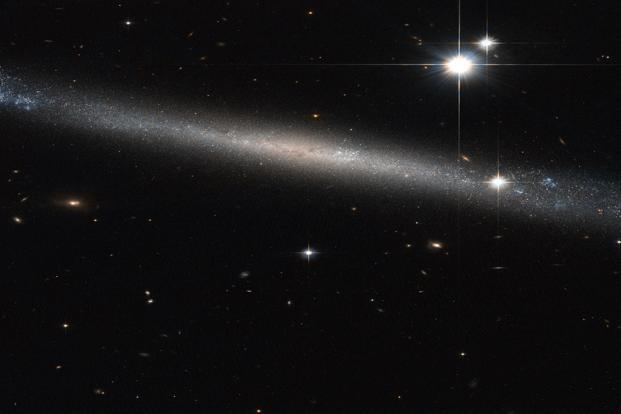 Unlike typical spirals, IC 2233 shows no well-defined dust lane. Photo: Nasa