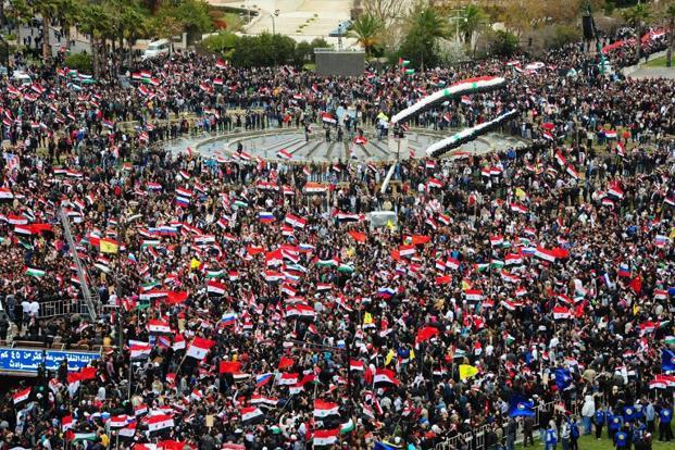 Syrians gather in Damascus's Umawiyin Sqare on the first anniversary of the anti-Assad revolt on 15 March 2012.