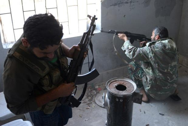 A file photo of rebel fighters firing their guns towards pro-Syrian government troops in the Bustan al-Bashar district of the northern Syrian city of Aleppo. Syria's civil war is the longest and deadliest conflict to emerge from uprisings that began sweeping the Arab world in 2011 and has developed a significant sectarian element. Photo: AFP