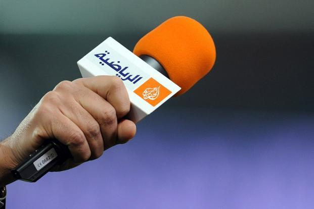 A file picture showing a microphone with the logo of Qatar-based Al Jazeera. Photo: AFP