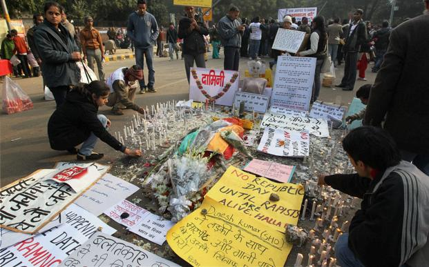 "People paying tribute to the gang-rape victim at Jantar Mantar in New Delhi on Thursday. ""We kept shouting at the police, 'please give us some clothes' but they were busy deciding which police station our case should be registered at,"" the man said. Photo: PTI"