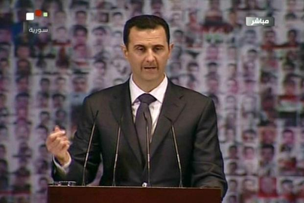 Syrian President Bashar al-Assad making a public address on the latest developments in the country and the region on Sunday. Photo: Syrian TV/AFP