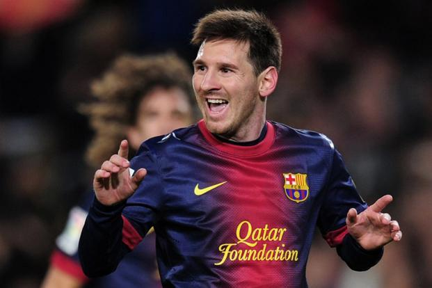 Messi scored a remarkable 91 goals in the calendar year, overtaking Gerd Muller's mark of 85. Here, he celebrates after scoring off a penalty kick during a Spanish league match against Espanyol in Barcelona on 6 January 2013. AFP