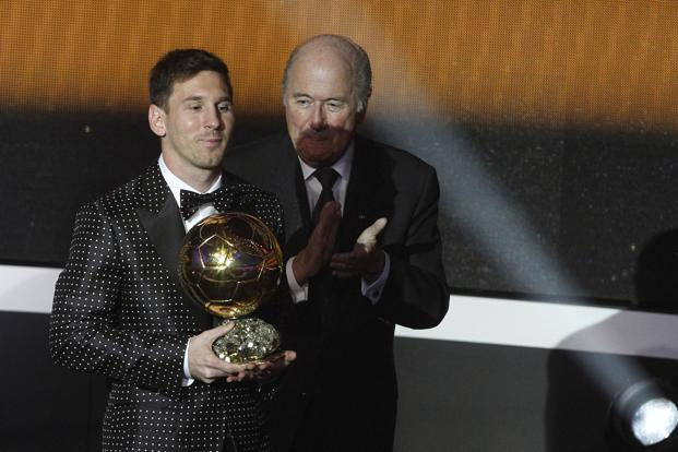 Fifa president Sepp Blatter (right) applauds as Lionel Messi receives the World Player of the Year 2012 award in Zurich on Monday. Photo: Arnd Wiegmann/Reuters