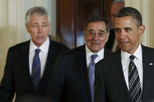 US President Barack Obama (right) arrives in the East Room of the White House with his nominee for defence secretary, Chuck Hagel (left), and current defence secretary Leon Panetta, on Monday. Photo: Kevin Lamarque/Reuters