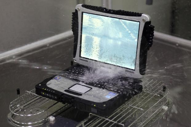 Panasonic's Toughbook computer undergoes water resistance testing at a factory in Kobe, Japan. Photo: Reuters