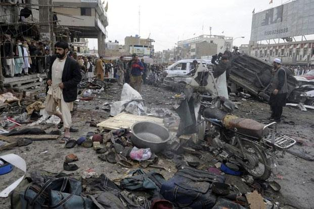 Debris and mangled vehicles at the site of a bomb explosion in Quetta on Thursday. Photo: AFP