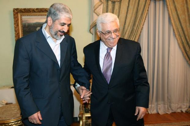 A file photo of Palestinian President Mahmoud Abbas (right) with the exiled leader of the Palestinian Islamist movement Hamas Khaled Meshaal in Cairo, Egypt. Photo: AFP