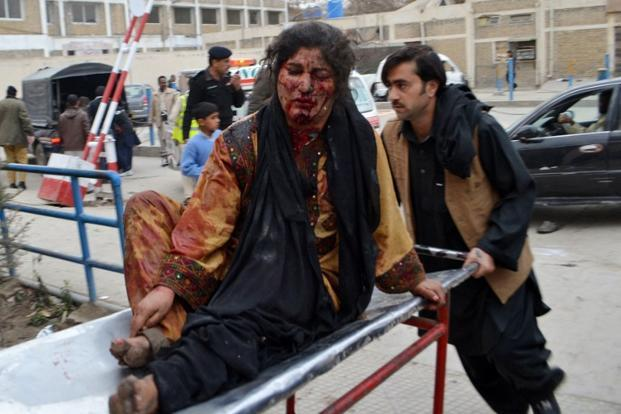 A man pushes a stretcher carring an injured blast victim to a hospital after the bomb explosion. Sunni militant group Lashkar-e-Jhangvi claimed responsibility for what was the worst single attack ever on the minority community. AFP