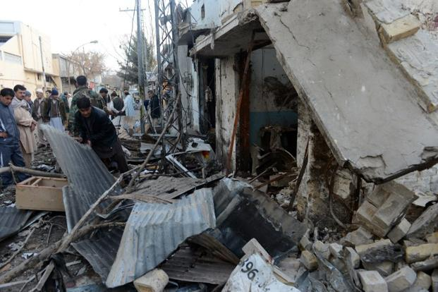 The site of the overnight twin suicide bombings in Quetta on 11 January. The bombings damaged several shops and nearby buildings. AFP