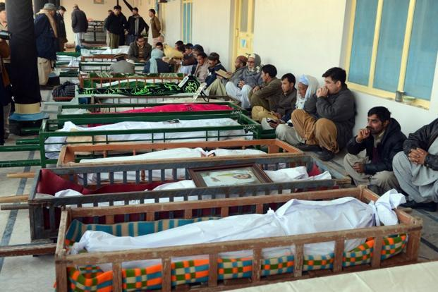 Mourners sit beside the coffins of blast victims at a mosque following overnight twin suicide bombings in Quetta. Pakistani Shiite Muslim accounts for around 20 percent of Pakistan's 180 million-strong population. AFP