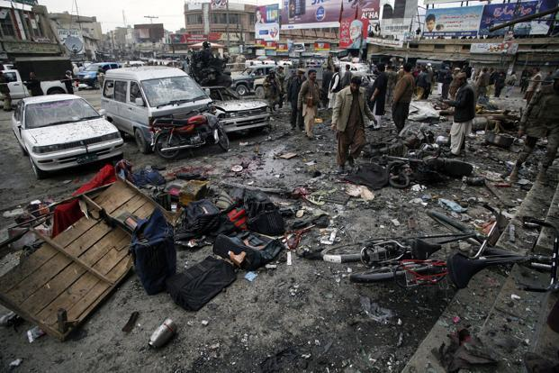 Police officials and civilians gather at the scene of the bomb explosion in Quetta. At least 82 people were killed and 121 wounded on Thursday when two suicide bombers blew themselves up at a crowded snooker club in Quetta. Reuters