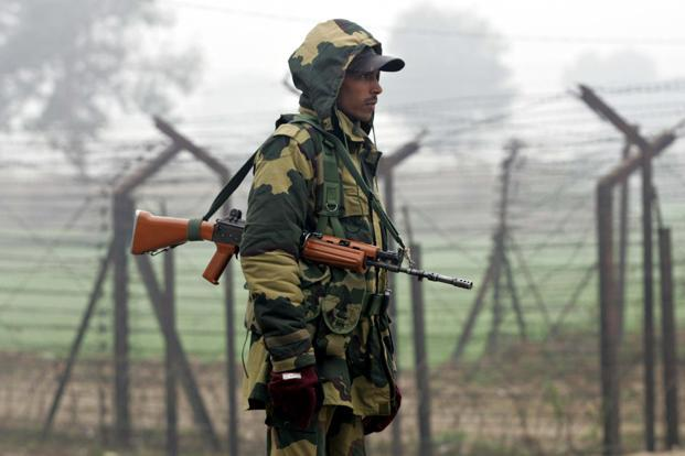 A file photo of a BSF soldier standing guard near fencing along the India-Pakistan border at Wagah. Pakistan Army had on Thursday refused to open the gates for allowing cross-LoC trade in Chakan-Da-Bagh crossing point in Poonch district of Jammu and Kashmir. Photo: AFP