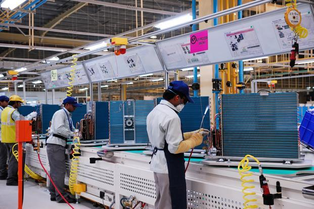 Thirteen out of the 22 industry groups in the manufacturing sector contracted in November 2012 from the corresponding month of the previous year. Photo: Priyanka Parashar/Mint