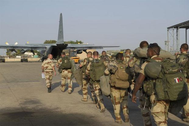 French troops prepare to board a transport plane in N'Djamena, Chad, on Saturday. France has sent troops to protect the Mali capital Bamako. Photo: Reuters