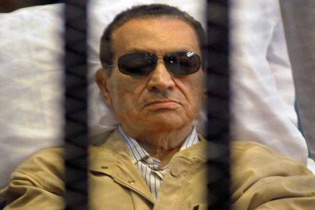 A file photo of former Egyptian president Hosni Mubarak siting inside a cage in a courtroom during his verdict hearing in Cairo. Photo: AFP