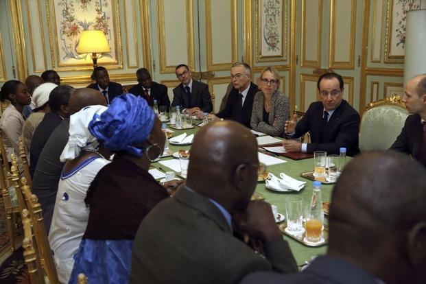 French President Francois Hollande (second from right) speaks with members of Malian associations in France during a meeting at the Elysee Palace in Paris on Sunday. Photo: Philippe Wojazer/Reuters
