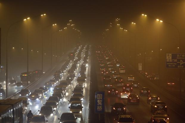 Vehicles drive on the Third Ring Road in Beijing. The city's pollution monitoring centre warned residents to stay indoors. Reuters