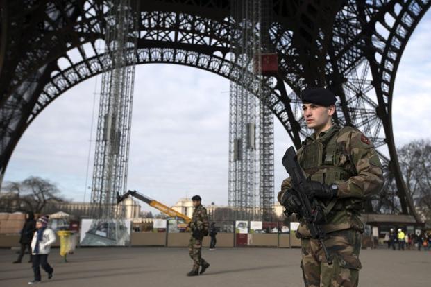 Soldiers patrol under the Eiffel Tower on Monday in Paris. Photo: Joel Saget/AFP (Joel Saget/AFP)