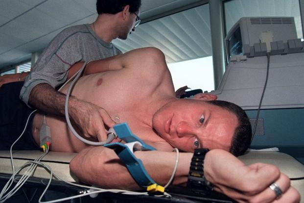 30 June 1995: A picture taken  in Saint-Brieuc, western France, shows Lance Armstrong undergoing the routine medical check-up before the 1995 Tour de France. AFP