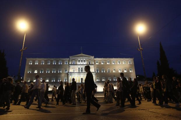 A file photo of Greece parliament. Greece's economy is being kept afloat by international rescue loans from other euro zone members and IMF, which were granted on condition that the country impose spending cuts and other austerity measures. Photo: Reuters