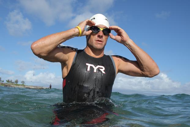 23 October 2011: Armstrong warms up before the swimming portion of the Xterra World Championship triathlon in Kapalua, Hawaii . Reuters