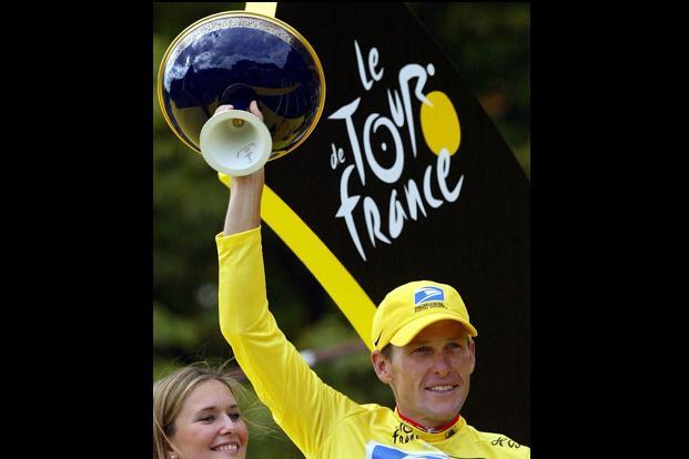 27 July 2003: US Lance Armstrong celebrating on the podium at the end of the 20th and last stage of the 90th Tour de France cycling race between Ville d'Avray and Paris Champs Elysees. AFP