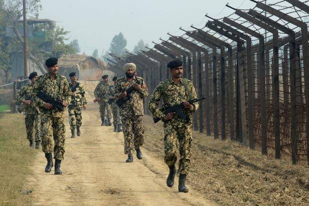 A file photo of Indian Border Security Force soldiers patrolling along the India-Pakistan border fence about 27km from Wagah. Photo: AFP