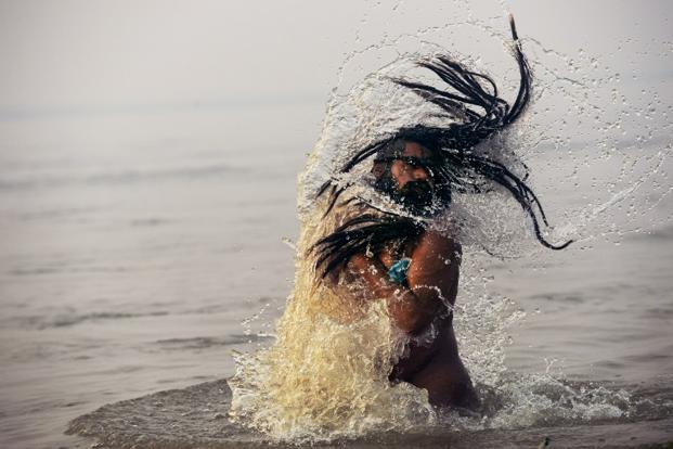 A Naga sadhu comes up after a dip. Naga sadhus are a particular group of Shaivite saints who reside in the Himalayan Caves and come down only during the Kumbh Mela. AFP