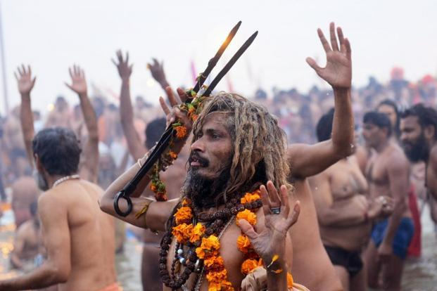 A sadhu bathes with others like him at the Sangam. The last Maha Kumbh in 2001 saw 70 million people congregating in Prayag. The festival will conclude on Maha Shivratri on 10 March. AFP