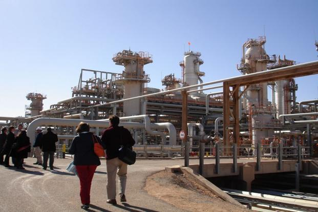 A file picture shows a foreign delegation visiting the Krechba gas treatment plant run by the Sonatrach, BP and Statoil in In Amenas. Photo: AFP