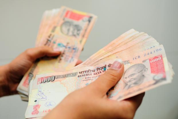 Sustained dollar demand from oil firms and weak regional risk sentiment prompted investors to cover short dollar positions. Photo: Priyanka Parashar/Mint