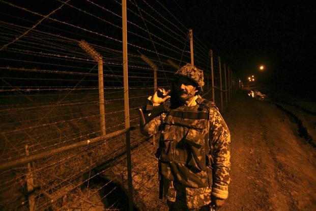 A BSF soldier patrols near the fenced border with Pakistan in Suchetgarh, southwest of Jammu on Saturday. Photo: Reuters