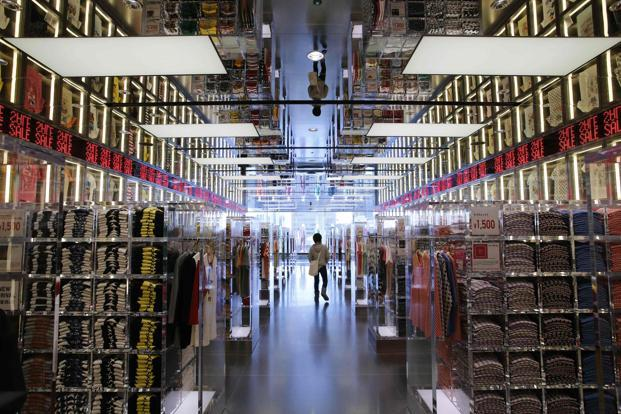 A shopper walks in Fast Retailing's Uniqlo casual clothing store in Tokyo. Photo: Reuters