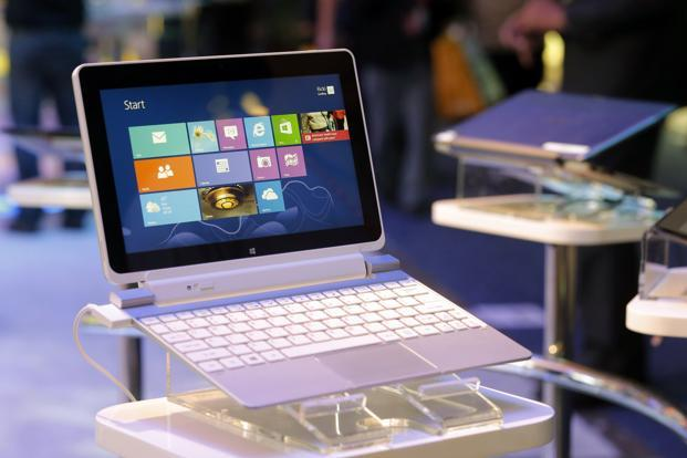 At last week's Consumer Electronics Show in Las Vegas, devices on display from Intel and others underscored the PC industry's plan to bet more on convertible laptops. Photo: AP