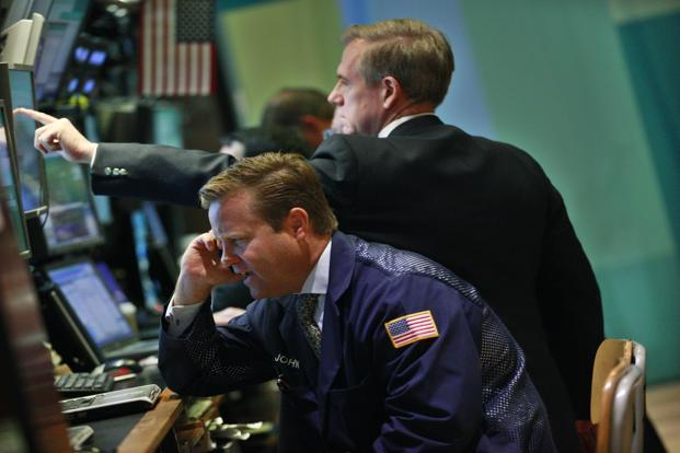 Traders working on the floor of the New York Stock Exchange. Photo: Reuters