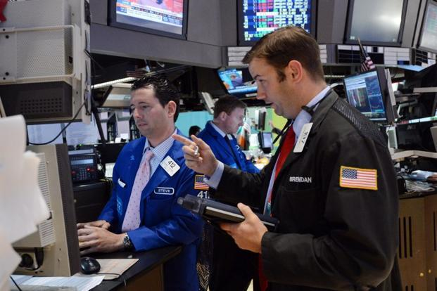 A file photo of traders working on the floor of the New York Stock Exchange. Photo: AFP