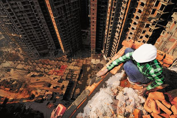 Mohamed Shamshad is a bricklayer who works right on the edge of the buildings under construction, without any harness. Photographs by Pradeep Gaur/Mint