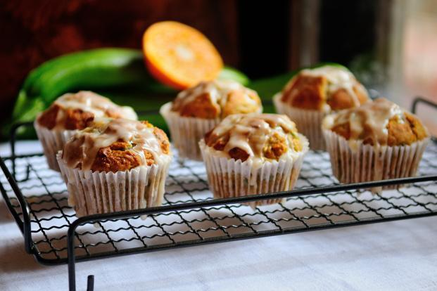 Take muffins out of the oven and leave to cool for a few minutes before drizzling the icing over the top