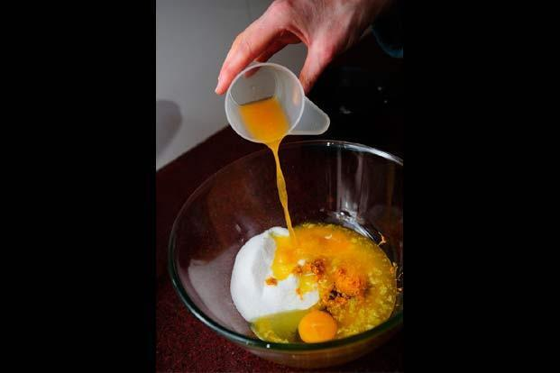 In another bowl whisk the sugar, eggs, zest, 50ml juice and oil until thick and foamy, about 3-4 minutes