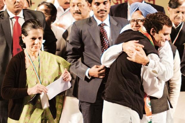 Rahul Gandhi hugs Manmohan Singh as Sonia Gandhi looks on in Jaipur on Sunday. Photo: AFP