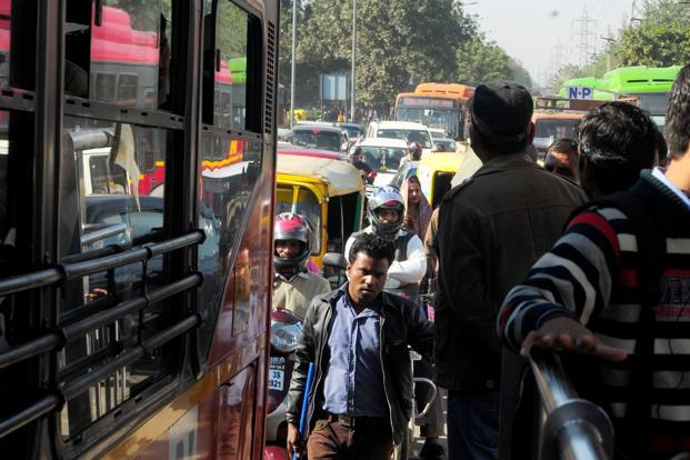 Traffic at a bus stop in Chirag Dilli. Photo: Ramesh Pathania/Mint