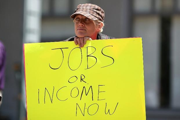 A protestor during a demonstration against unemployment in Oakland, California. Some 39 million people have dropped out of the labour market as job prospects proved unattainable, opening a 67 million global jobs gap since 2007. AFP