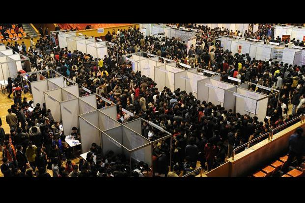 Thousands of job-seekers gather at a job fair in Hefei, China. The global number of unemployed is expected to rise further to some 210.6 million over the next five years, the ILO report said. AFP