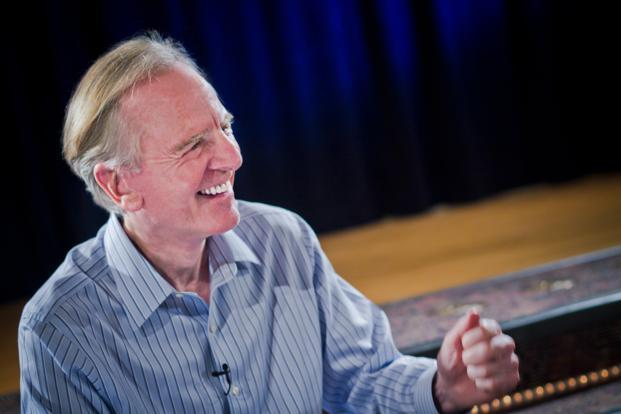 John Sculley says he will probably spend about $100 million over the next year to buy companies in India or finance existing businesses through equity capital.