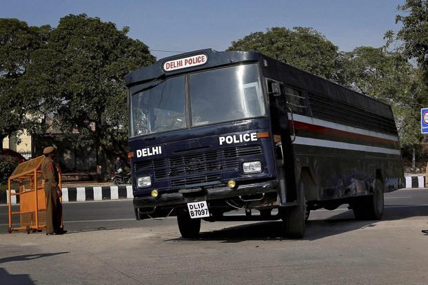 A Delhi Police van, said to be carrying the accused in a gang-rape of a 23-year-old woman, enters Saket district court in New Delhi on Monday. Photo: PTI